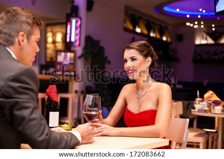 Couple in a romantic dinner drinking  with wine - stock photo