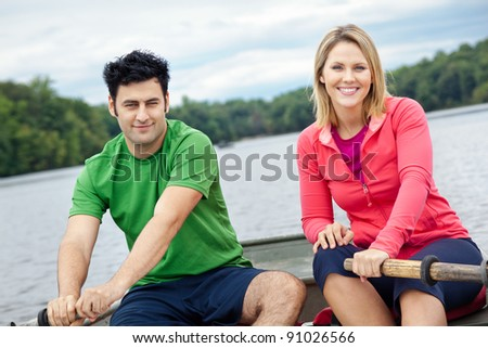 Couple in a rowboat on a lake - stock photo