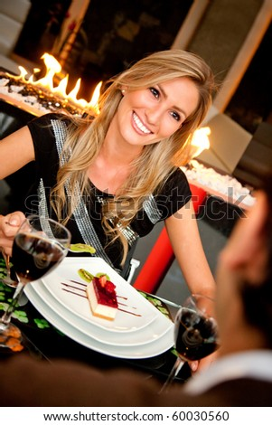 Couple in an elegant restaurant having a romantic dinner - stock photo