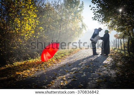 Couple in beautiful foggy and sunny mysterious nature - stock photo