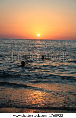 couple in beautiful sunset in greece