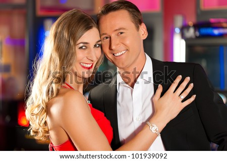 Couple in Casino in a playful mood and very in love - stock photo