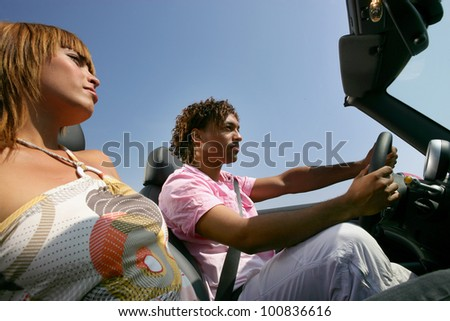 Couple in convertible car - stock photo