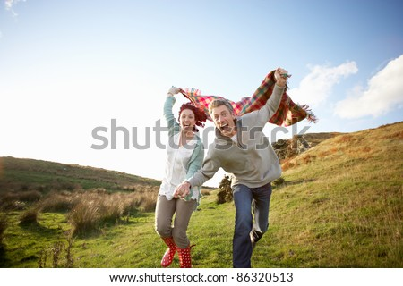Couple in countryside - stock photo