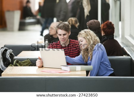 Couple in front of a computer - stock photo