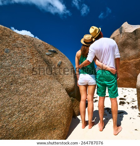 Couple in green on a tropical beach at Seychelles - stock photo