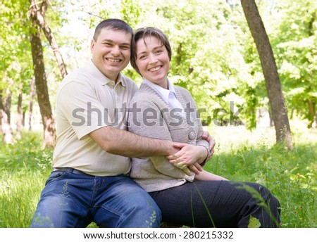Couple in green summer park - stock photo