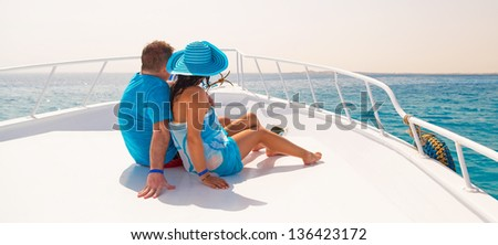 Couple in hug relaxing on the luxury yacht cruise