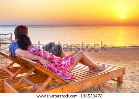 Couple in hug watching together sunrise over Red Sea in Egypt - stock photo