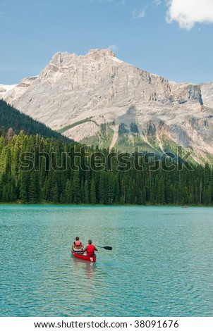couple in kayak on a canadian lake - stock photo