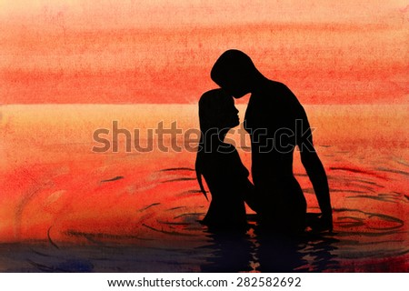 couple in love at sunset in the sea - stock photo