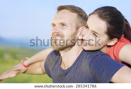 Couple in love at sunset smiling enjoy outdoor pastime. - stock photo
