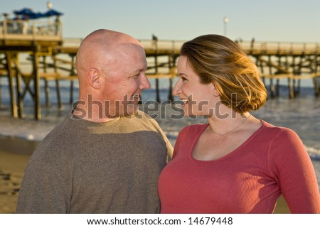 Couple in love at the beach looking into each others eyes - stock photo