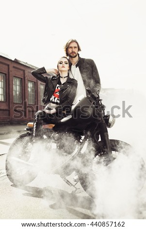 Couple in love. Bikers and vintage custom motorcycle. Outdoor lifestyle portrait - stock photo
