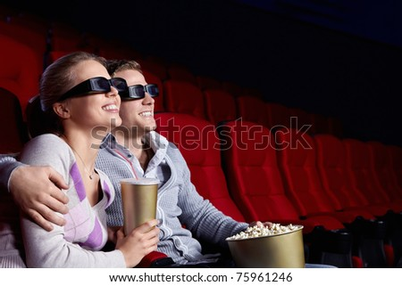 Couple in love 3D glasses in cinema - stock photo
