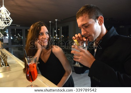 http://thumb9.shutterstock.com/display_pic_with_logo/1545944/339789542/stock-photo-couple-in-love-drinking-cocktails-in-an-elegant-bar-at-night-339789542.jpg
