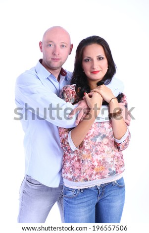 Couple in love embracing isolated on white background