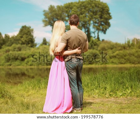 Couple in love enjoying nature - stock photo