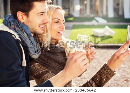 couple in love gets a Selfie while drinking aperitif - stock photo