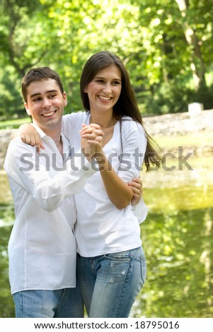 couple in love having fun at the park - stock photo