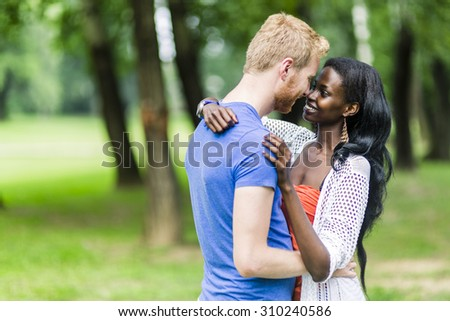 Couple in love hugging peacefully outdoors and being truly happy. Feeling of security and serenity