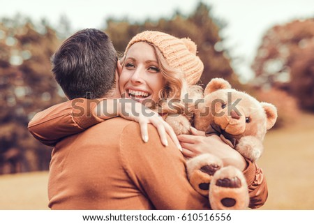 Couple in love in autumn Smiling young couple hugging in the park. Couple Hugging Stock Images  Royalty Free Images   Vectors