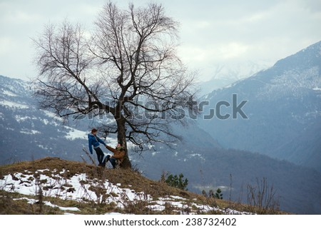 Couple in love in beautiful mountains - stock photo