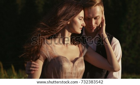 Couple in love in the mountains at sunset