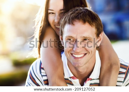 Couple in love kissing laughing having fun. Caucasian man, Asian woman