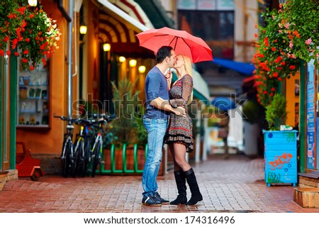 couple in love kissing under the rain - stock photo