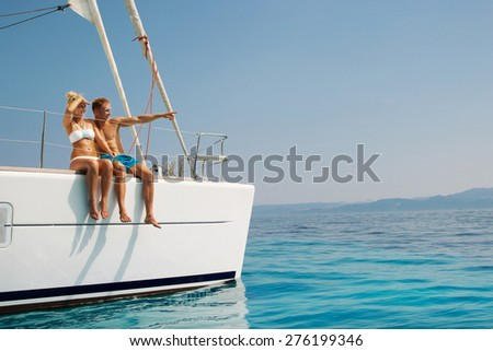 Couple in love on a sail boat in the summer. - stock photo