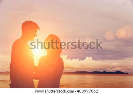 Couple in love on the background of the sea and rocks - stock photo