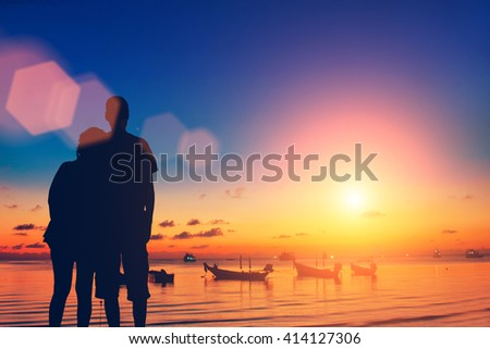Couple in love on the background of the sea, sky and  boats - stock photo