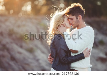 couple in love on the beach in autumn - stock photo