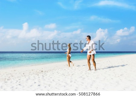 Couple in love on the beach. Wedding in the Maldives.