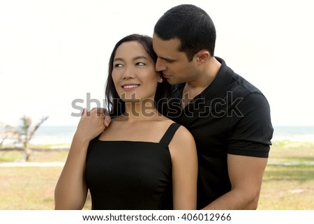 Couple in love outdoor.Stunning sensual outdoor portrait of interracial happy couple. Asian woman,Caucasian man - stock photo