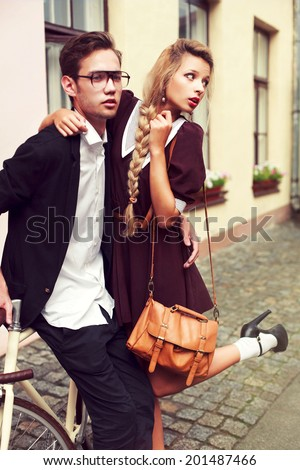 Couple in love pretty young blond woman having fun with her handsome hipster style boyfriend and seductive look