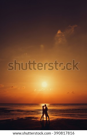 Couple in love silhouette during sunset - touching noses - stock photo