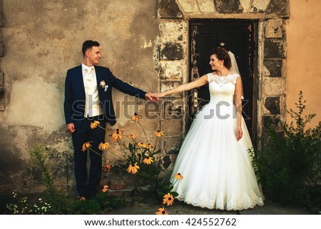 Couple in love standing near house