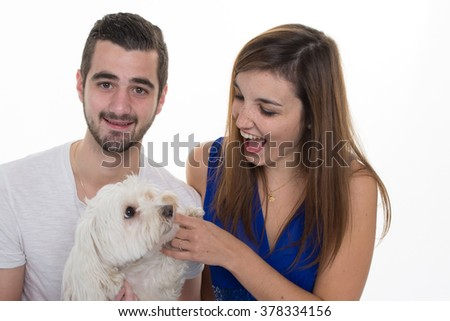 Couple in love with a white dog  isolated on white - stock photo