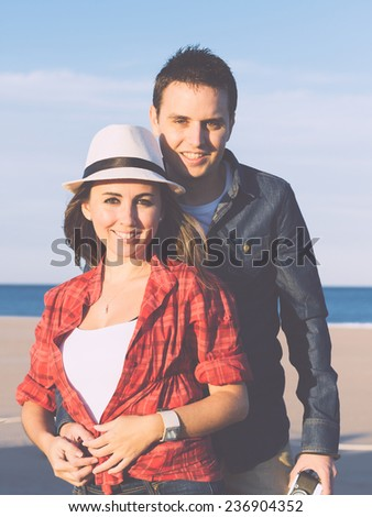 Couple in love with beach background. Vintage filter effect