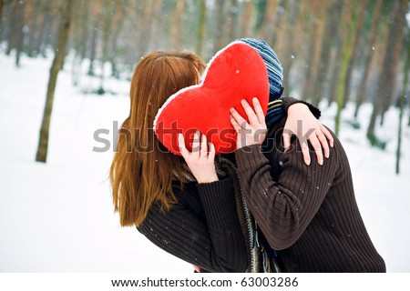 Couple in love with red heart - stock photo