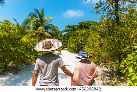 Couple in paradise walking Concept