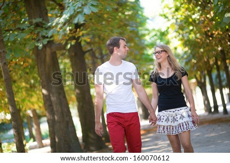 Couple in park on a summer or early fall day