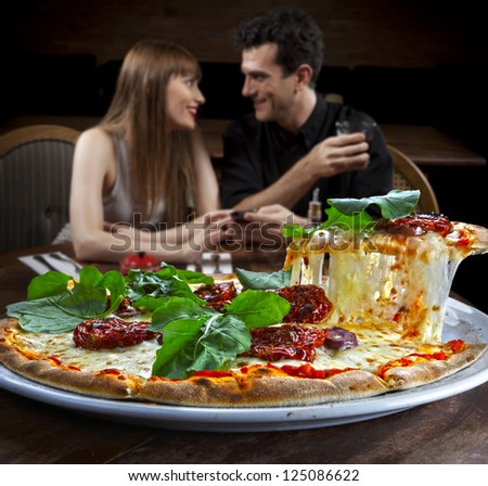 Couple in pizzeria - stock photo