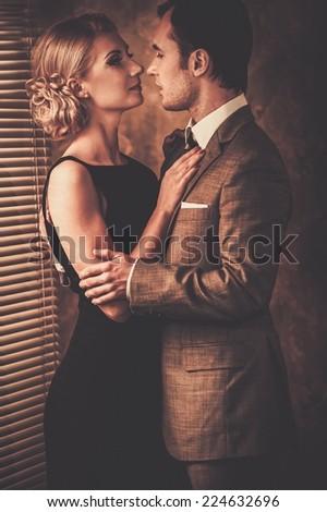 Couple in retro interior near a window - stock photo
