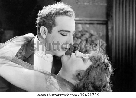 Couple in romantic embrace - stock photo