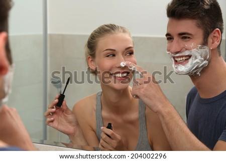 Couple in the bathroom - stock photo
