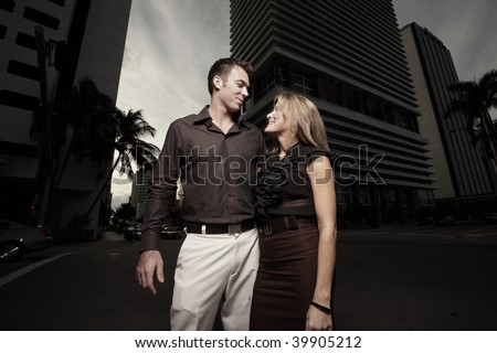 Couple in the city at night - stock photo
