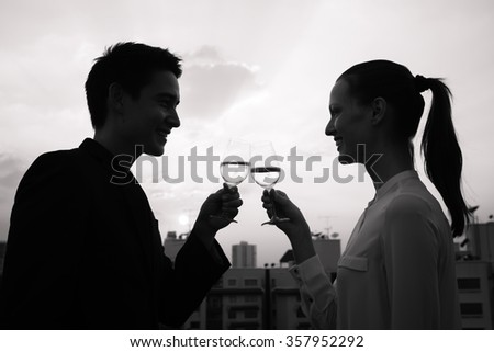 Couple in the city drinking wine.  - stock photo